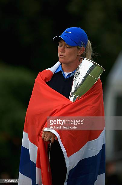 Suzann Pettersen of Norway closes her eyes during the Norwiegen national anthem after securing victory in the third round of The Evian Championship...