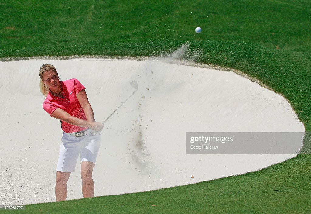 <a gi-track='captionPersonalityLinkClicked' href=/galleries/search?phrase=Suzann+Pettersen&family=editorial&specificpeople=218091 ng-click='$event.stopPropagation()'>Suzann Pettersen</a> of Norway hits a shot during the Birdies for Breast Cancer Foundation Liberty Cup at Liberty National Golf Club on August 30, 2011 in Jersey City, New Jersey.