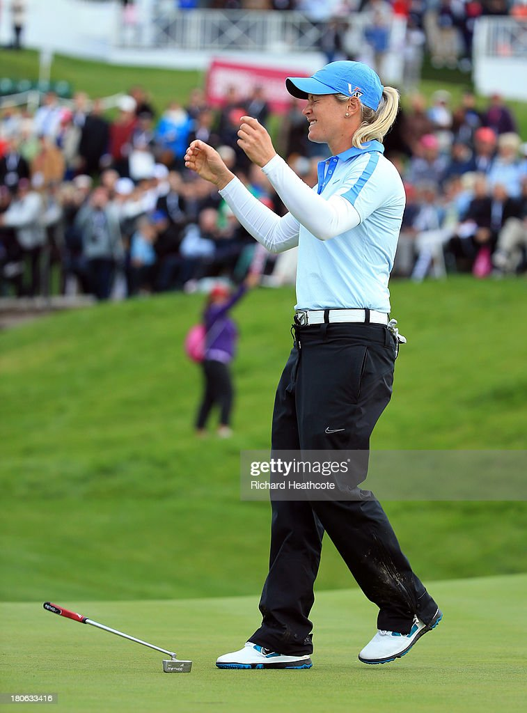<a gi-track='captionPersonalityLinkClicked' href=/galleries/search?phrase=Suzann+Pettersen&family=editorial&specificpeople=218091 ng-click='$event.stopPropagation()'>Suzann Pettersen</a> of Norway holes the winning putt on the 18th green during the third round of The Evian Championship at the Evian Resort Golf Club on September 15, 2013 in Evian-les-Bains, France.
