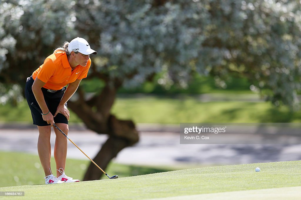 <a gi-track='captionPersonalityLinkClicked' href=/galleries/search?phrase=Suzann+Pettersen&family=editorial&specificpeople=218091 ng-click='$event.stopPropagation()'>Suzann Pettersen</a> of Norway lines up her ball on the ninth green during the second round of the LPGA LOTTE Championship Presented by J Golf at the Ko Olina Golf Club on April 18, 2013 in Kapolei, Hawaii.