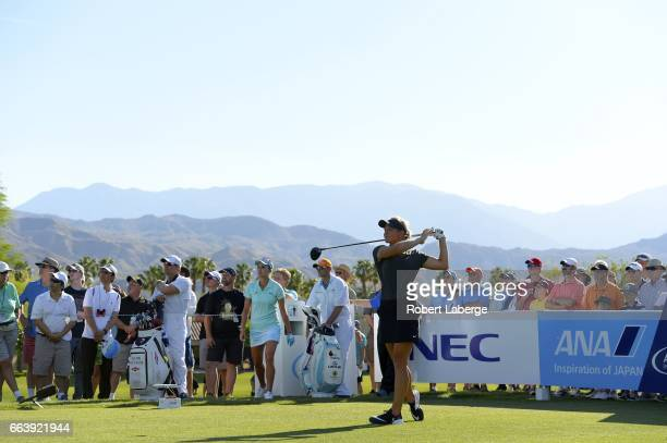 Suzann Pettersen of Norway makes a tee shot on the 12th hole during the final round of the ANA Inspiration on the Dinah Shore Tournament Course at...