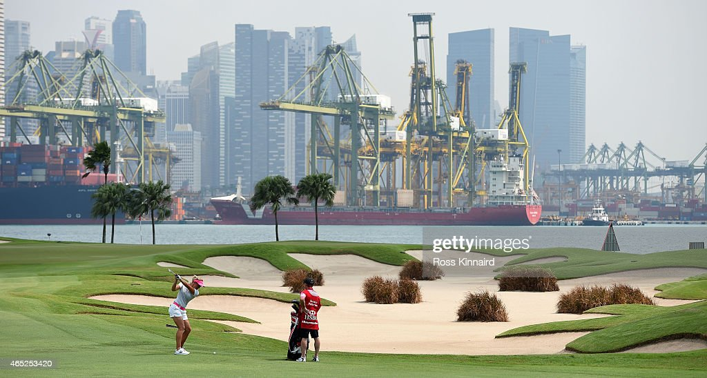 Suzann Pettersen of Norway plays her second shot on the par four 5th hole during the first round of the HSBC Women's Champions at the Sentosa Golf...