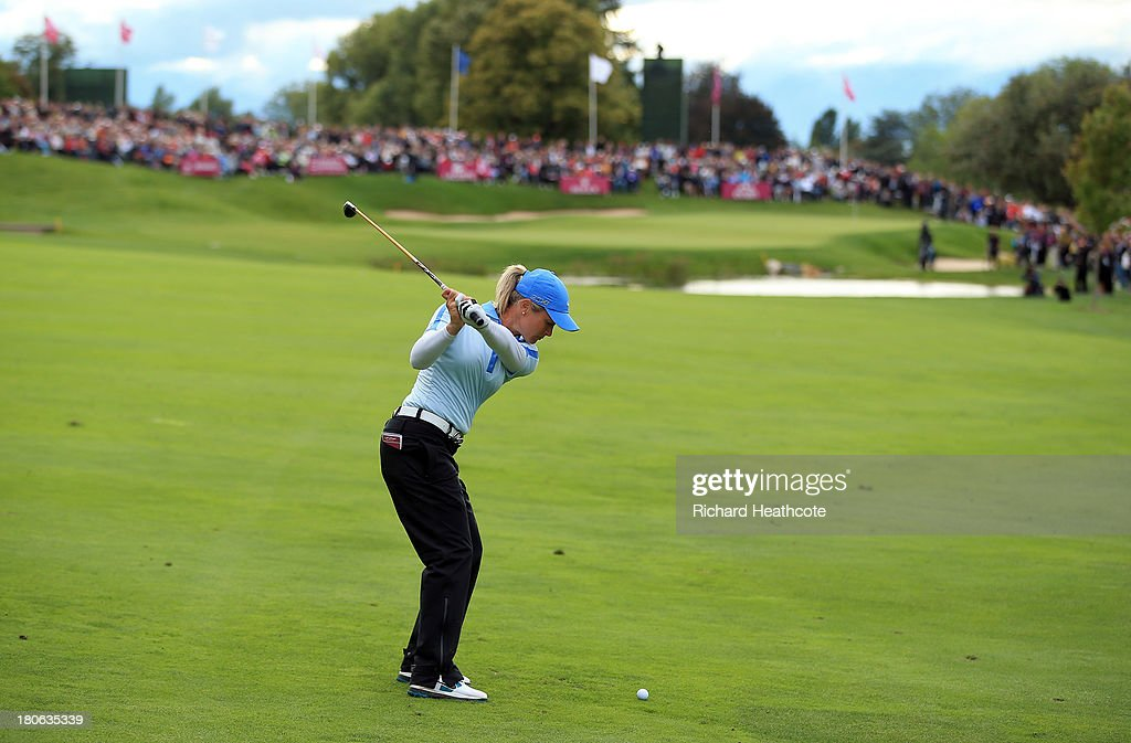 <a gi-track='captionPersonalityLinkClicked' href=/galleries/search?phrase=Suzann+Pettersen&family=editorial&specificpeople=218091 ng-click='$event.stopPropagation()'>Suzann Pettersen</a> of Norway plays into the 18th green during the third round of The Evian Championship at the Evian Resort Golf Club on September 15, 2013 in Evian-les-Bains, France.