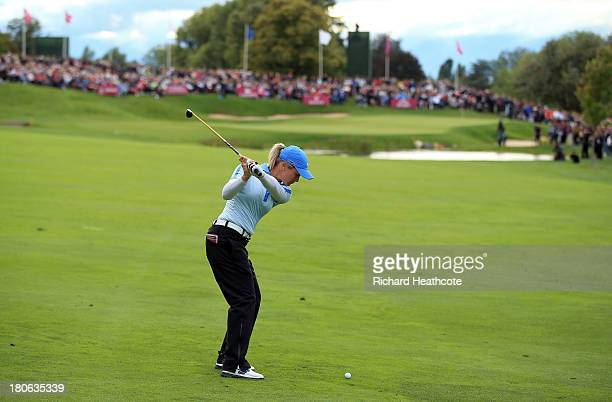 Suzann Pettersen of Norway plays into the 18th green during the third round of The Evian Championship at the Evian Resort Golf Club on September 15...