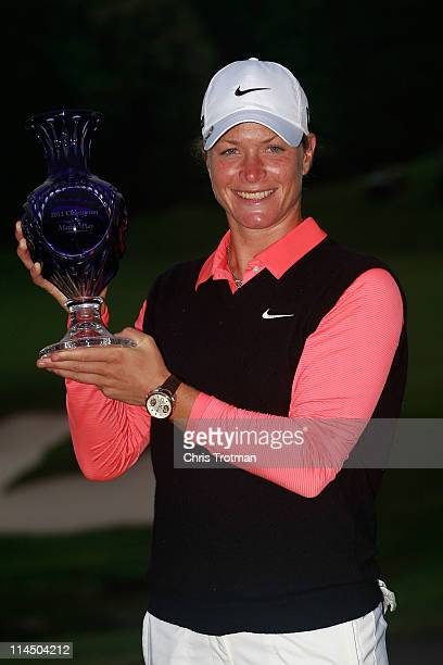 Suzann Pettersen of Norway poses with the trophy following her victory against Cristie Kerr in the final of the Sybase Match Play Championship at...