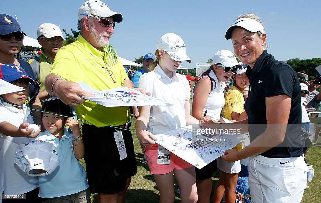 Suzann Pettersen of Norway signs autographs for fans during the final round of the 2013 North Texas LPGA Shootout at the Las Colinas Counrty Club on April 28, 2013 in Irving, Texas.