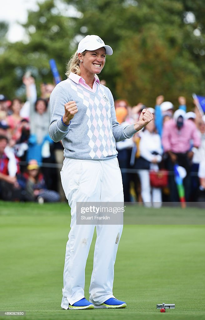 Suzann Pettersen of team Europe celebrates winning her match during the morning foursomes matches at The Solheim Cup at St LeonRot Golf Club on...
