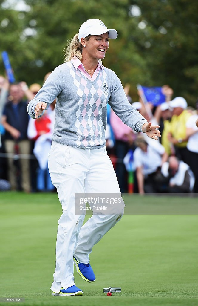 <a gi-track='captionPersonalityLinkClicked' href=/galleries/search?phrase=Suzann+Pettersen&family=editorial&specificpeople=218091 ng-click='$event.stopPropagation()'>Suzann Pettersen</a> of team Europe celebrates winning her match during the morning foursomes matches at The Solheim Cup at St Leon-Rot Golf Club on September 19, 2015 in St Leon-Rot, Germany