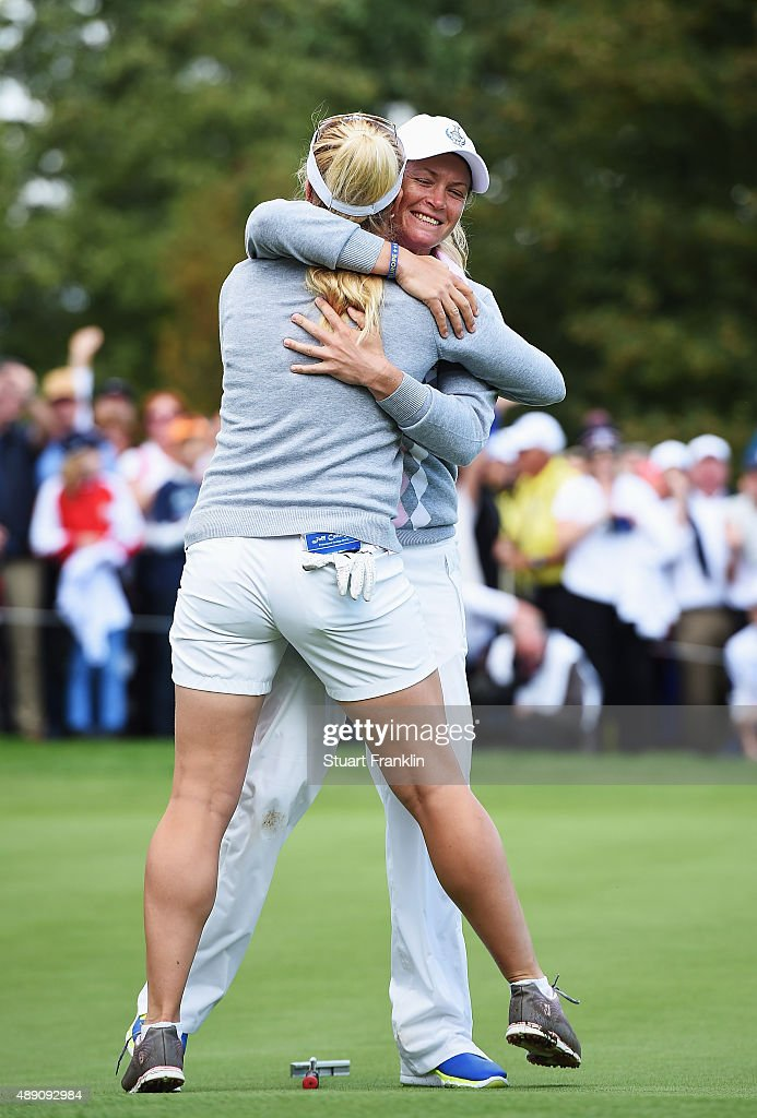Suzann Pettersen of team Europe celebrates with Charley Hull after winning their match during the morning foursomes matches at The Solheim Cup at St...