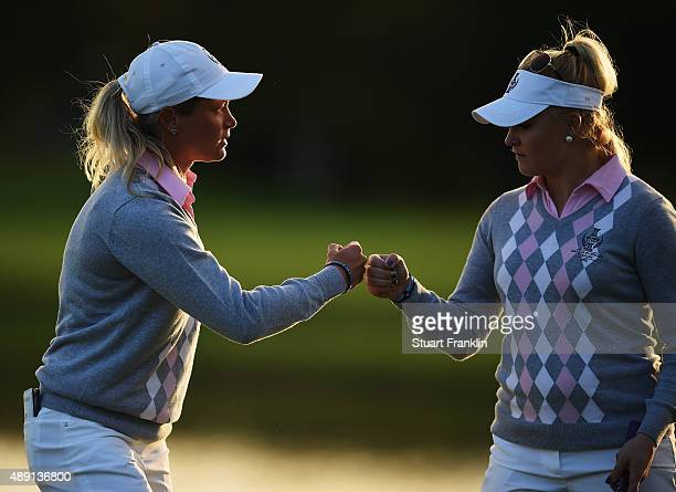 Suzann Pettersen of team Europe high fives with Charley Hull during the afternoon fourball matches at The Solheim Cup at St LeonRot Golf Club on...