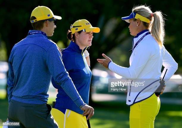 Suzann Pettersen of Team Europe speaks to Caroline Masson during practice for the Solheim Cup at the Des Moines Golf and Country Club on August 17...