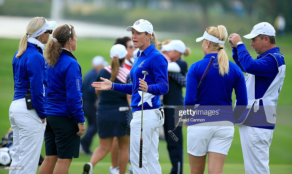 <a gi-track='captionPersonalityLinkClicked' href=/galleries/search?phrase=Suzann+Pettersen&family=editorial&specificpeople=218091 ng-click='$event.stopPropagation()'>Suzann Pettersen</a> of the European team trying to explain to her captain <a gi-track='captionPersonalityLinkClicked' href=/galleries/search?phrase=Carin+Koch&family=editorial&specificpeople=208667 ng-click='$event.stopPropagation()'>Carin Koch</a> (l) the length of putt that she did not concede to Alison Lee on the 17th green in her match with <a gi-track='captionPersonalityLinkClicked' href=/galleries/search?phrase=Charley+Hull&family=editorial&specificpeople=7118530 ng-click='$event.stopPropagation()'>Charley Hull</a> (r) against Alison Lee and Brittany Lincicome of the United States during the completion of the Saturday afternoon fourball matches in the 2015 Solheim Cup at St Leon-Rot Golf Club on September 20, 2015 in Sankt Leon-Rot, Germany.
