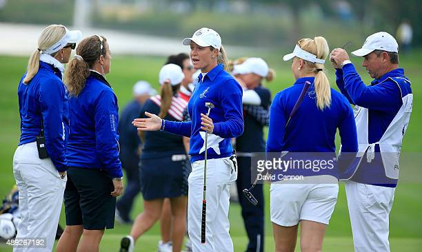 Suzann Pettersen of the European team trying to explain to her captain Carin Koch the length of putt that she did not concede to Alison Lee on the...