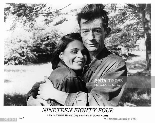 Suzanna Hamilton is held by John Hurt on set of the film '1984' 1984
