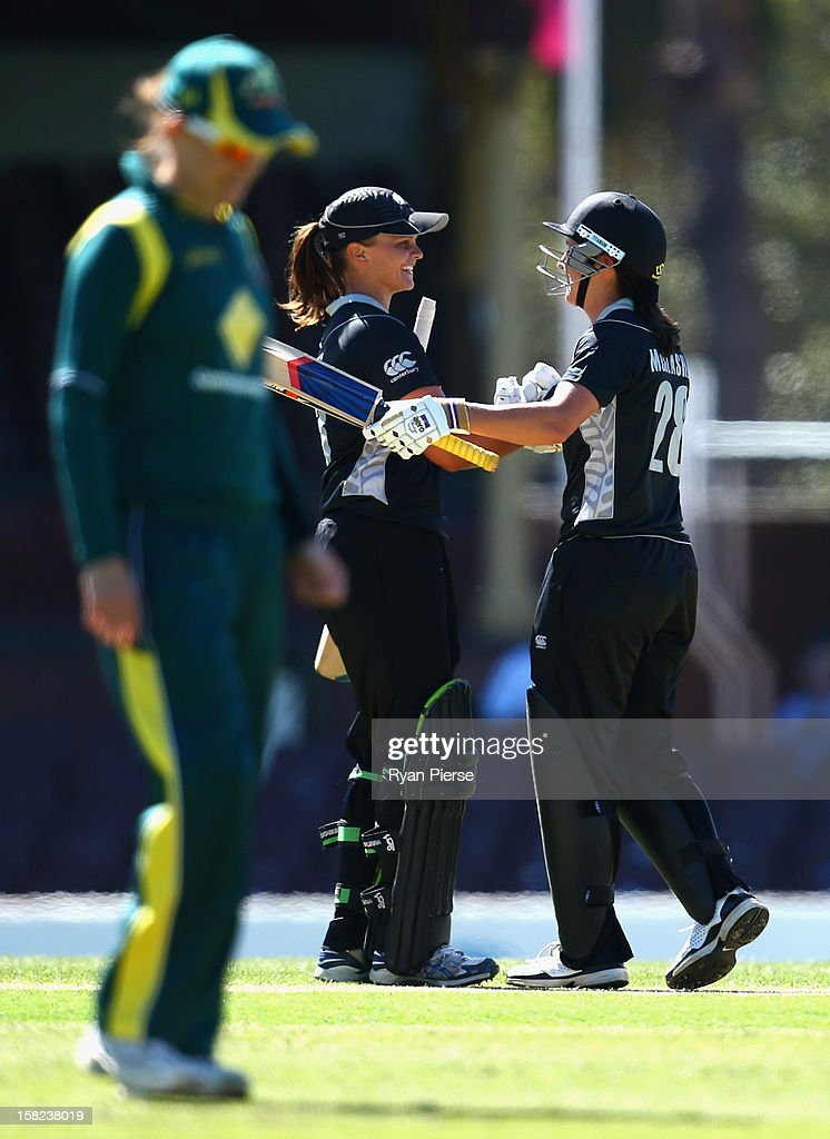 Suzannah Bates (L) of New Zealand celebrates with Sara McGlashan (R) of New Zealand after reaching her century during the first Rose Bowl Series One Day International match between Australia Southern Stars and New Zealand Silver Ferns at the Sydney Cricket Ground on December 12, 2012 in Sydney, Australia.
