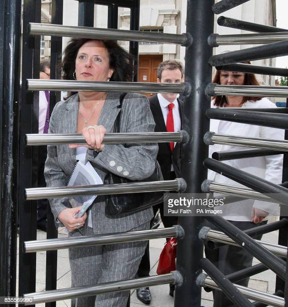 Suzanne Breen northern editor of the Dublinpublished Sunday Tribune arrives at the Northern Ireland High Court where she will resist an attempt by...