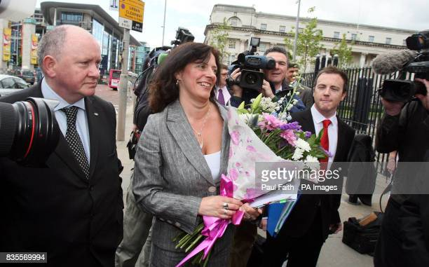 Suzanne Breen northern editor of the Dublinpublished Sunday Tribune is greeted by colleagues as she arrives at the Northern Ireland High Court where...