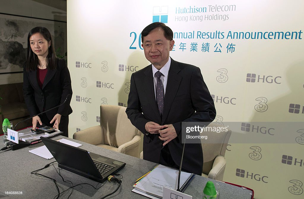 Suzanne Cheng chief financial officer of Hutchison Telecommunications Hong Kong Holdings Ltd left and Peter Wong chief executive officer of Hutchison...