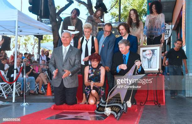 Suzanne DesrocherRomero widow of the late film director George Romero flanked by filmaker Edgar Wright special effect makeup artist/producer Greg...
