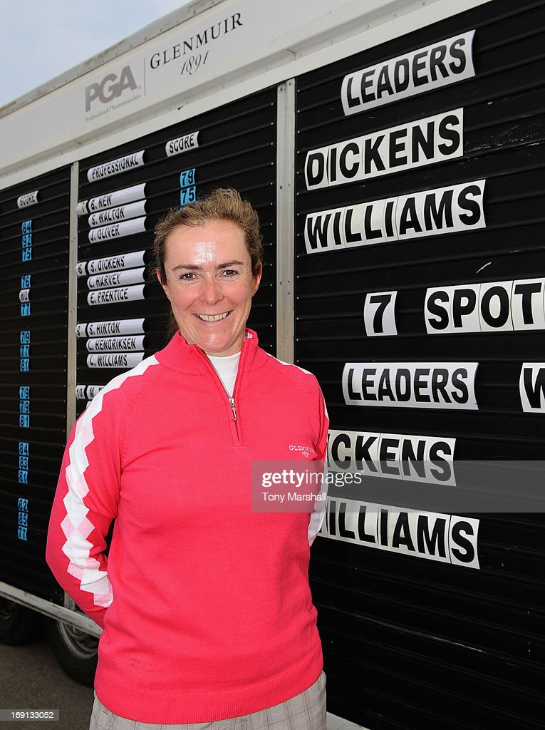 Suzanne Dickens of Nene Park Golf Club poses infront of the scoreboard during the Glenmuir Women's PGA Professional Championship - Regional Qualifier at Little Aston Golf Club on May 20, 2013 in Birmingham, England.