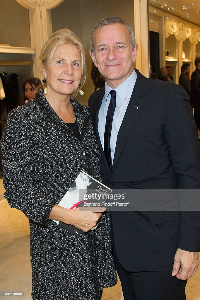 Suzanne Flammarion, the wife of publisher Alain Flammarion (L) and Francis Huster attend the signing of Huster's book 'And Dior Created Woman' at Dior Boutique on November 19, 2012 in Paris, France.