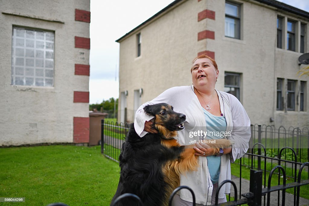 Suzanne Hogg and her dog Tyson stand in a garden in the Tannahill area of Ferguslie Park on August 31 2016 in PaisleyScotland For the second...