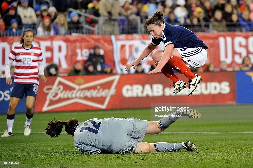 Suzanne Malone #9 of the Scotland Women's National Team jumps over teammate goal keeper Lynn Shannon #12 during a match against the U.S. Women's National Team at LP Field on February 13, 2013 in Nashville, Tennessee.