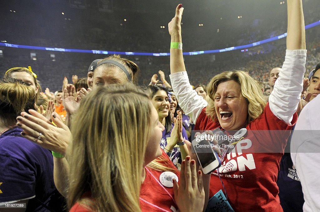 Suzanne Petry excitedly jumps around after a message from Bon Jovi was played through the Bryce Jordan Center in State College, Pennsylvania, Sunday, February 17, 2013, announcing and announced that Four Diamond Families would be given tickets for his up coming show. Petry, who lost her son, Blair Peters, to cancer last year, said this is another way she knows he is watching over their family.