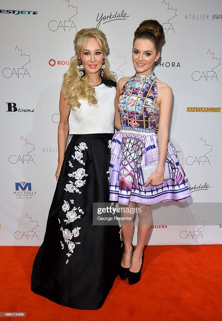 Suzanne Rogers and <a gi-track='captionPersonalityLinkClicked' href=/galleries/search?phrase=Chloe+Rogers&family=editorial&specificpeople=730554 ng-click='$event.stopPropagation()'>Chloe Rogers</a> arrives at the 1st Annual Canadian Arts and Fashion Awards at the Fairmont Royal York Hotel on February 1, 2014 in Toronto, Canada.