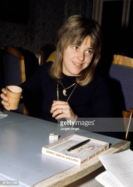 Suzi Quatro poses in January 1979 playing yahtzee in Copenhagen Denmark