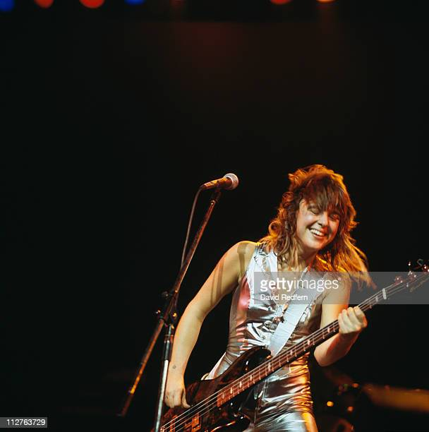 Suzi Quatro US singersongwriter playing the bass guitar during a live concert performance on stage at Hammersmith Odeon London England Great Britain...