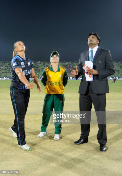 Suzie Bates captain of New Zealand Mignon Du Preez captain of South Africa and ICC match referee Javagal Srinath during the toss before the start of...