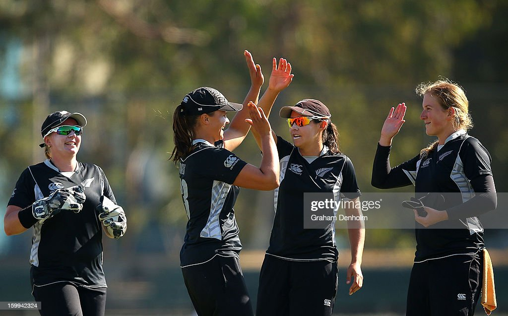 Suzie Bates of New Zealand (2-L) celebrates with teammates after she caught out Alyssa Healy of Australia during the Women's International Twenty20 match between the Australian Southern Stars and New Zealand at Junction Oval on January 24, 2013 in Melbourne, Australia.