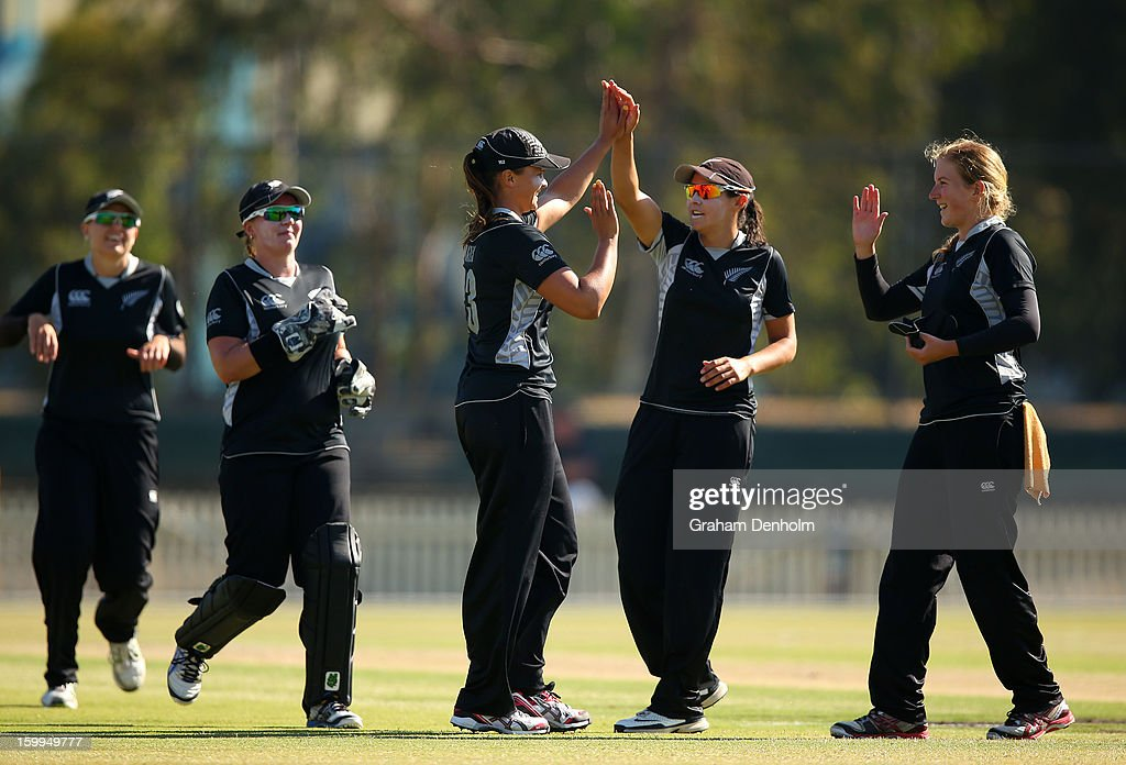 Suzie Bates of New Zealand (C) celebrates with teammates after she caught out Alyssa Healy of Australia during the Women's International Twenty20 match between the Australian Southern Stars and New Zealand at Junction Oval on January 24, 2013 in Melbourne, Australia.