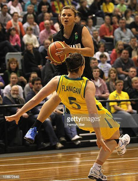 Suzie Bates of New Zealand collides with Rachael Flanagan of Australia during the first match between the Australian Opals and the New Zealand Tall...