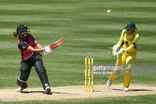 Suzie Bates of New Zealand plays a ramp shot over Alyssa Healy of Australia during the Women's Twenty20 International match between the Australia...
