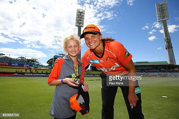 Suzie Bates of the Scorchers poses with a T20 Blast kid during the Women's Big Bash League match between the Perth Scorchers and the Sydney Sixers at...