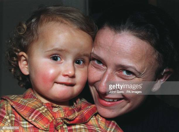 Suzie Maine can now hear her daughter Alice talk thanks to a pioneering operation which involved inserting a new type of cochlear implant behind her...