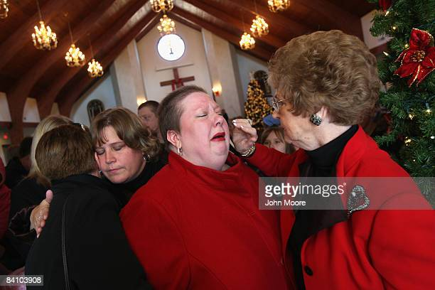 Suzie Xavier is blessed by pastor Elizabeth Looney following a prayer service at the Wilmington Church of God December 21 2008 in Wilmington Ohio...