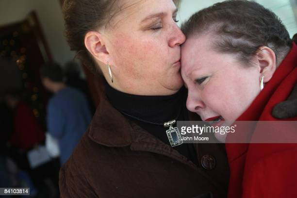 Suzie Xavier is comforted by her friend Ronda Woodgeared following a prayer service at the Wilmington Church of God December 21 2008 in Wilmington...
