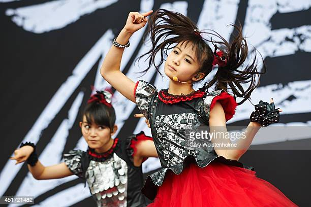 Suzuka Nakamoto and Yui Mizuno of BABYMETAL performs on stage at Sonisphere at Knebworth Park on July 5 2014 in Knebworth United Kingdom