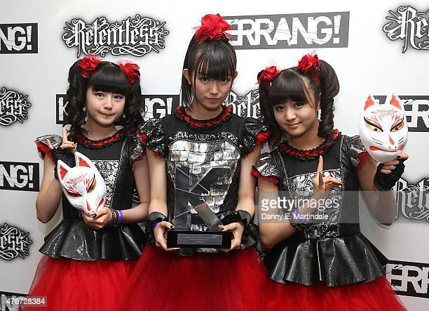 Suzuka Nakamoto as 'Sumetal' Yui Mizuno as 'Yuimetal' and Moa Kikuchi as 'Moametal' from Baby Metal are seen with there award at the Relentless...