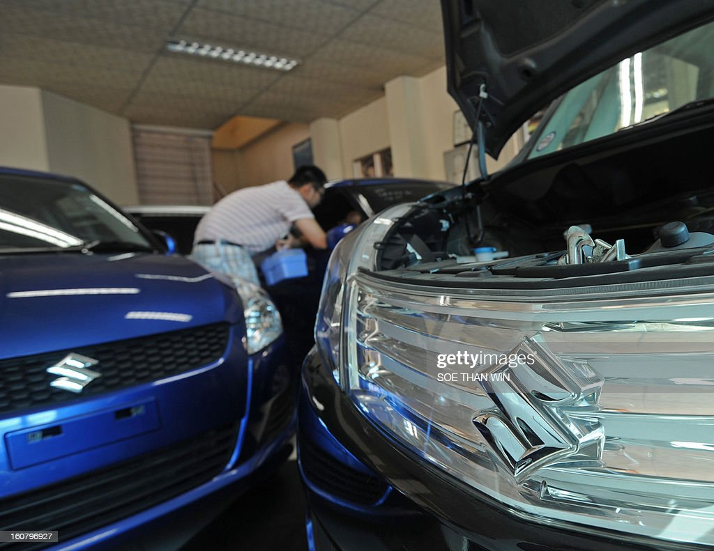 Suzuki cars are displayed at a show room in Yangon on February 6, 2013. Japanese automaker Suzuki said on February 6 it will resume production in Myanmar, the latest in a push by Asia's second-biggest economy to tap the once-isolated state. AFP PHOTO/ Soe Than WIN