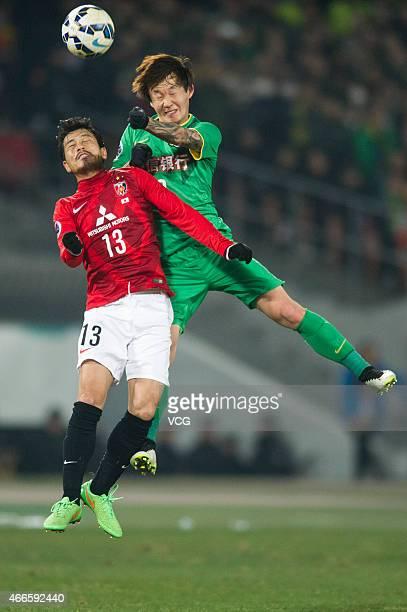 Suzuki Keita#13 Of Urawa Red Diamonds competes the ball during the AFC Asian Champions League match between the Beijing Guoan and Urawa Red Diamonds...