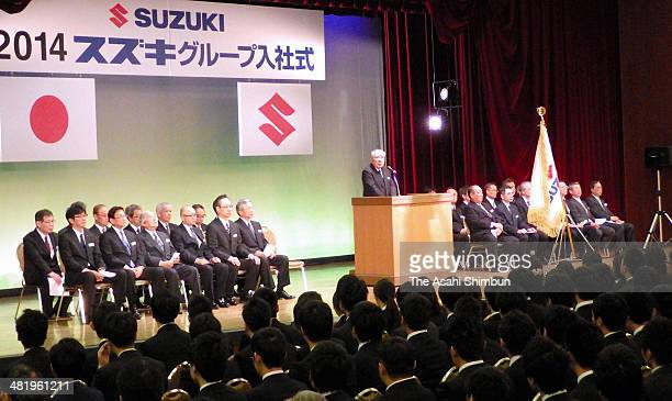 Suzuki Motor Co Chairman and president Osamu Suzuki speaks to new emploees during a welcoming ceremony on April 1 2014 in Hamamatsu Shizuoka Japan...