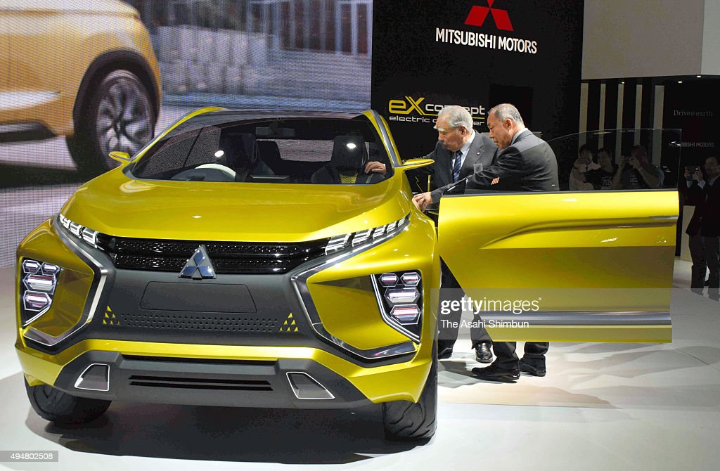 Suzuki Motor Co Chairman <a gi-track='captionPersonalityLinkClicked' href=/galleries/search?phrase=Osamu+Suzuki&family=editorial&specificpeople=580987 ng-click='$event.stopPropagation()'>Osamu Suzuki</a> (L) inspects an electric vehicle at Mitsubishi Motors booth during the Tokyo Motor Show at Tokyo Big Sight on October 29, 2015 in Tokyo, Japan.