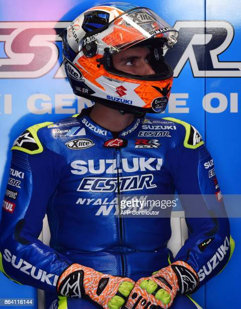 Suzuki rider Alex Rins of Spain gets ready to ride during the third practice session of the Australian MotoGP Grand Prix at Phillip Island on October...
