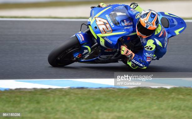 Suzuki rider Alex Rins of Spain powers his machine during the qualifying session of the Australian MotoGP Grand Prix at Phillip Island on October 21...