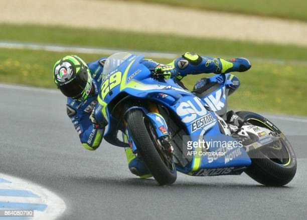 Suzuki rider Andrea Iannone of Italy crashes during the third practice session of the Australian MotoGP Grand Prix at Phillip Island on October 21...