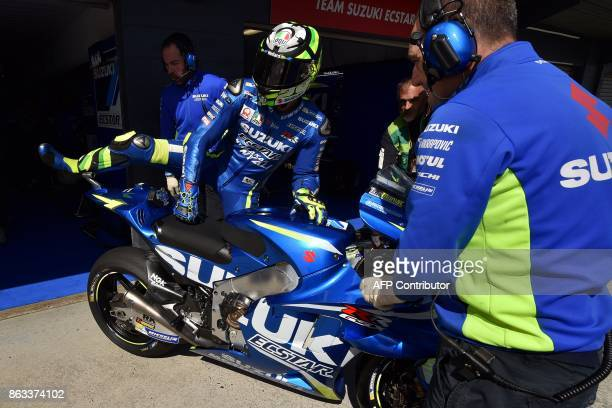 Suzuki rider Andrea Iannone of Italy gets ready to leave the pit lane during the second practice session of the Australian MotoGP Grand Prix at...